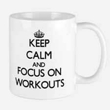 Keep Calm by focusing on Workouts Mugs