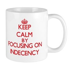 Keep Calm by focusing on Indecency Mugs