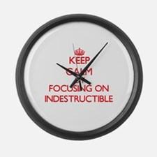 Keep Calm by focusing on Indestru Large Wall Clock