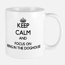 Keep Calm by focusing on Being In The Doghous Mugs