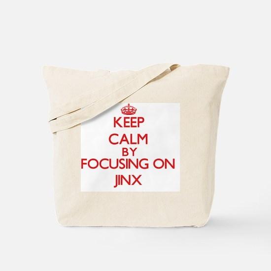 Keep Calm by focusing on Jinx Tote Bag