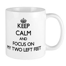 Keep Calm by focusing on My Two Left Feet Mugs