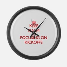 Keep Calm by focusing on Kickoffs Large Wall Clock
