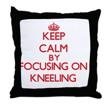 Keep Calm by focusing on Kneeling Throw Pillow