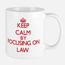 Keep Calm by focusing on Law Mugs