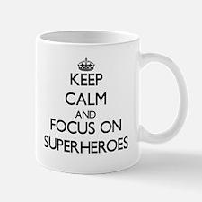 Keep Calm by focusing on Superheroes Mugs