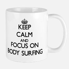 Keep Calm by focusing on Body Surfing Mugs