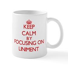 Keep Calm by focusing on Liniment Mugs