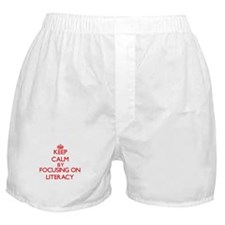 Keep Calm by focusing on Literacy Boxer Shorts