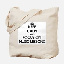 Keep Calm by focusing on Music Lessons Tote Bag
