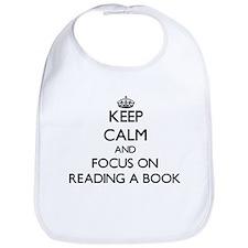Keep Calm by focusing on Reading A Book Bib