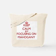 Keep Calm by focusing on Mahogany Tote Bag