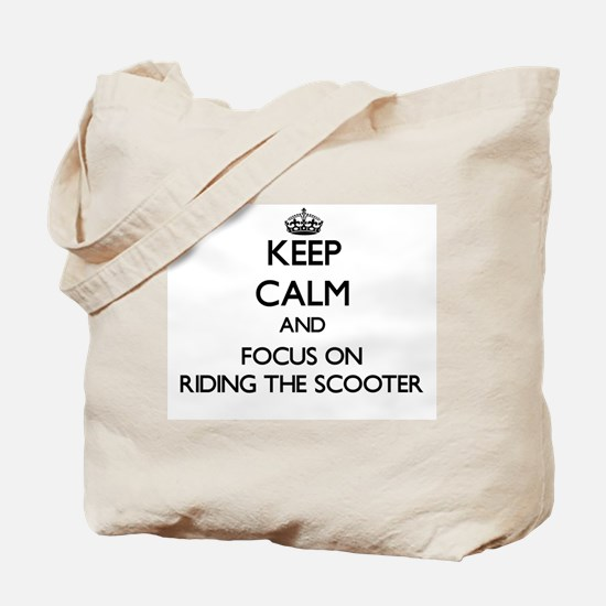 Keep Calm by focusing on Riding The Scoot Tote Bag