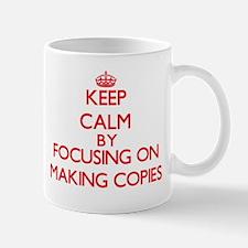 Keep Calm by focusing on Making Copies Mugs