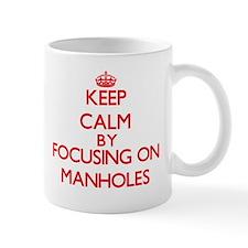 Keep Calm by focusing on Manholes Mugs