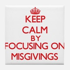 Keep Calm by focusing on Misgivings Tile Coaster