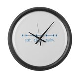 Eat sleep swim Wall Clocks
