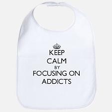 Keep Calm by focusing on Addicts Bib