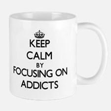 Keep Calm by focusing on Addicts Mugs