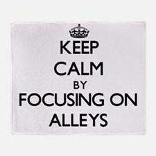 Keep Calm by focusing on Alleys Throw Blanket