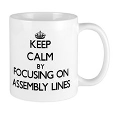 Keep Calm by focusing on Assembly Lines Mugs