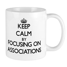 Keep Calm by focusing on Associations Mugs