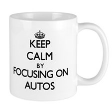 Keep Calm by focusing on Autos Mugs