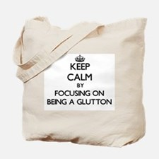 Keep Calm by focusing on Being A Glutton Tote Bag