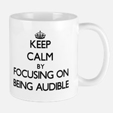 Keep Calm by focusing on Being Audible Mugs