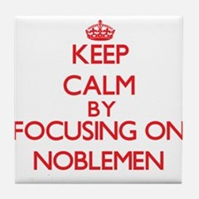 Keep Calm by focusing on Noblemen Tile Coaster