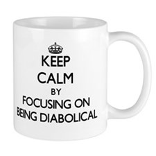 Keep Calm by focusing on Being Diabolical Mugs