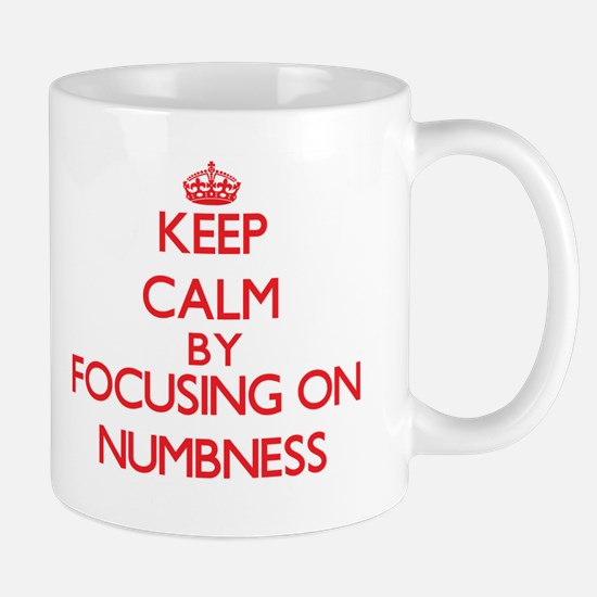 Keep Calm by focusing on Numbness Mugs