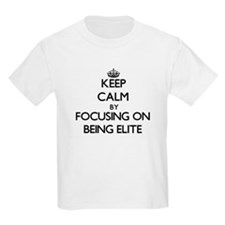 Keep Calm by focusing on BEING ELITE T-Shirt