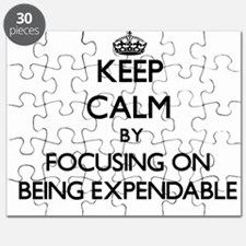 Keep Calm by focusing on BEING EXPENDABLE Puzzle