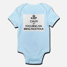 Keep Calm by focusing on Being Facetious Body Suit