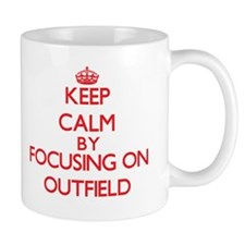 Keep Calm by focusing on Outfield Mugs