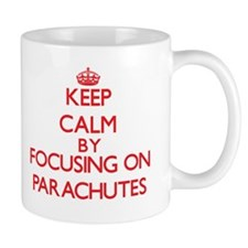 Keep Calm by focusing on Parachutes Mugs