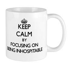 Keep Calm by focusing on Being Inhospitable Mugs