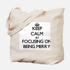 Keep Calm by focusing on Being Merry Tote Bag