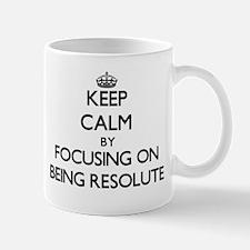 Keep Calm by focusing on Being Resolute Mugs