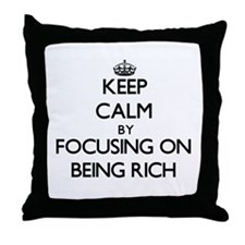 Keep Calm by focusing on Being Rich Throw Pillow