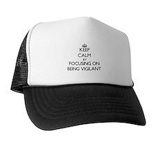 Keep Calm by focusing on Being Vigilan Trucker Hat