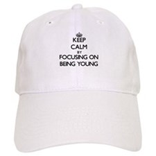 Keep Calm by focusing on Being Young Baseball Cap
