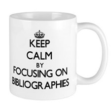 Keep Calm by focusing on Bibliographies Mugs