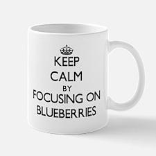 Keep Calm by focusing on Blueberries Mugs