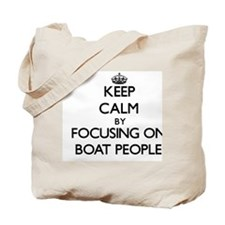 Keep Calm by focusing on Boat People Tote Bag