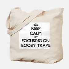 Keep Calm by focusing on Booby Traps Tote Bag