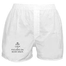 Keep Calm by focusing on Book Shelfs Boxer Shorts