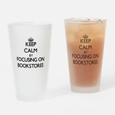Keep Calm by focusing on Bookstores Drinking Glass