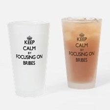 Keep Calm by focusing on Bribes Drinking Glass